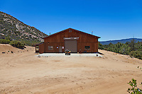 Stock photo of rustic barn on mountainous ranch property