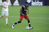 WASHINGTON, DC - AUGUST 25: Donovan Pines #23 of D.C. United moves the ball during a game between New England Revolution and D.C. United at Audi Field on August 25, 2020 in Washington, DC.