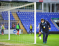 A member of Peterborough United ground staff uses a disinfectant spay to sanitise the goalpost during half-time as part of Covid-19 safety precautions <br /> <br /> Photographer Chris Vaughan/CameraSport<br /> <br /> The EFL Sky Bet League One - Peterborough United v Blackpool - Saturday 21st November 2020 - London Road Stadium - Peterborough<br /> <br /> World Copyright © 2020 CameraSport. All rights reserved. 43 Linden Ave. Countesthorpe. Leicester. England. LE8 5PG - Tel: +44 (0) 116 277 4147 - admin@camerasport.com - www.camerasport.com