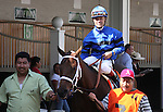 Tidal Pool with Jon Court up in the Churchill Downs paddock prior to running in The Debutante (grIII). 06.27.2009