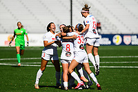 MONTCLAIR, NJ - OCTOBER 3: Bayley Feist #13 of the Washington Spirit jumps on the backs of teammates Meggie Dougherty Howard #8 of the Washington Spirit, Ashley Hatch #33 of the Washington Spirit, and Sam Staab #3 of the Washington Spirit as they celebrate a goal by Kumi Yokoyama #17 of the Washington Spirit during a game between Washington Spirit and Sky Blue FC at MSU Soccer Park at Pittser Field on October 3, 2020 in Montclair, New Jersey.