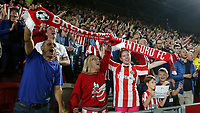 Brentford fans celebrate earning a point against Liverpool at the final whistle during Brentford vs Liverpool, Premier League Football at the Brentford Community Stadium on 25th September 2021