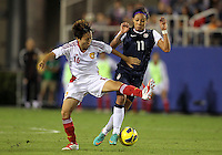 BOCA RATON, FL - DECEMBER 15, 2012: Sydney Leroux (11) of the USA WNT tries to move past Wang Chen (16) of China WNT during an international friendly match at FAU Stadium, in Boca Raton, Florida, on Saturday, December 15, 2012. USA won 4-1.