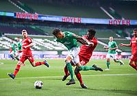 18th May 2020, WESERSTADION, Bremen, Germany; Bundesliga football, Werder Bremen versus Bayer Leverkusen; Edmond Tapsoba (Leverkusen) pulls back on Davie Selke (Bremen).