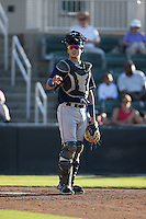 Asheville Tourists catcher Dom Nunez (9) looks to the dugout for defensive signs during the game against the Kannapolis Intimidators at Intimidators Stadium on June 28, 2015 in Kannapolis, North Carolina.  The Tourists defeated the Intimidators 6-4.  (Brian Westerholt/Four Seam Images)