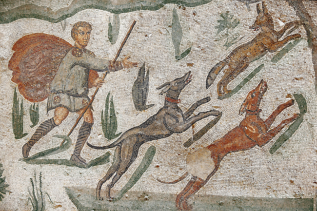 Hunter with dogs chasing a fox from the Room of The Small Hunt, no 25 - Roman mosaics at the Villa Romana del Casale 4th century AD. Sicily, Italy. A UNESCO World Heritage Site.