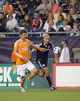 New England Revolution forward Ilica Stojica (9) moves down the wing as Houston Dynamo defender Bobby Boswell (32) defends. The New England Revolution defeated Houston Dynamo, 1-0, at Gillette Stadium on August 14, 2010.