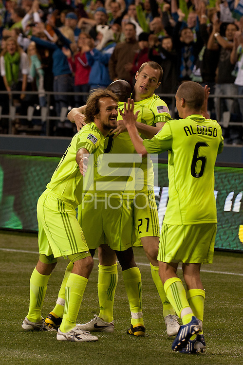 Seattle Sounders Roger Levesque, Blaize Nkufo, Nate Jaqua and Osvaldo Alonso (l to r) celebrate their 2010 US Open Cup Championship after defeating the Columbus Crew 2-1 at the XBox 360 Pitch at Quest Field in Seattle, WA on October 5, 2010.