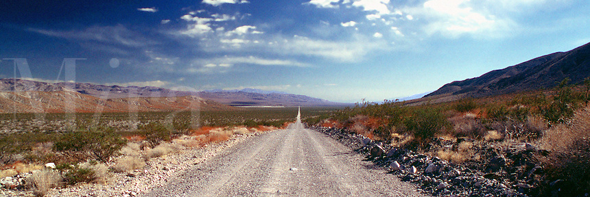 Long straight gravel road. Crankshaft Junction to Grapevine, Death Valley, California. Death Valley, California.