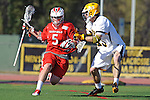 Baltimore, MD - March 3:  Defensemen/long stick midfielder Ethan Murphy #13 of the UMBC Retrievers defends Attackmen Eric Warden #5 of the Fairfield Stagsduring the Fairfield v UMBC mens lacrosse game at UMBC Stadium on March 3, 2012 in Baltimore, MD.