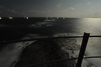Great Basses Reef Lighthouse surrounded by night fishermen 8 miles offshore southwestern Sri Lanka.