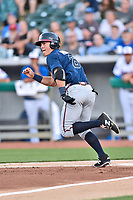 Mississippi Braves shortstop Dylan Moore (8) runs to first base during a game against the Tennessee Smokies at Smokies Stadium on April 12, 2017 in Kodak, Tennessee. The Braves defeated the Smokies 6-2. (Tony Farlow/Four Seam Images)