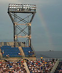 A rainbow colors the gray sky at the US Open in Flushing, NY on September 9, 2015.