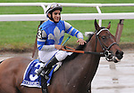 27 Sept 2008: Jockey Alan Garcia gives Dynaforce a pat on the shoulders after a wire-to-wire win in the Flower Bowl Invitational Stakes at Belmont Park in Elmont, New York on Jockey Club Gold Cup Day.