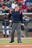 Home plate umpire Matt Neuhold loads up with baseballs between innings of the Midwest League game between the Great Lakes Loons and the Dayton Dragons at Fifth Third Field April 22, 2009 in Dayton, Ohio. (Photo by Brian Westerholt / Four Seam Images)