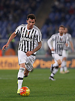 Calcio, Serie A: Lazio vs Juventus. Roma, stadio Olimpico, 4 dicembre 2015.<br /> Juventus' Mario Mandzukic in action during the Italian Serie A football match between Lazio and Juventus at Rome's Olympic stadium, 4 December 2015.<br /> UPDATE IMAGES PRESS/Isabella Bonotto