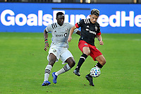 WASHINGTON, DC - NOVEMBER 8: Yamil Asad #11 of D.C. United battles for the ball with Victor Wanyama #2 of Montreal Impact during a game between Montreal Impact and D.C. United at Audi Field on November 8, 2020 in Washington, DC.