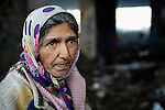 A woman who lived under a bridge in a Roma settlement in Belgrade, Serbia, when this photo was taken in February 2012. The families that lived here, most of whom survive from recycling cardboard and other materials, were forcibly evicted in April 2012. Many were moved into metal shipping containers on the edge of Belgrade..