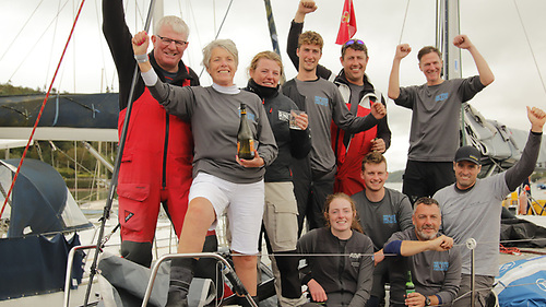"Nieulargo's crew after winning the Fastnet 450 are (left to right, standing) Denis, Annamarie & Molly Murphy, Mark ""Nipper"" Murphy (no relation), Killian Collins and Clive O'Shea, front row Mia Murphy, Cian Byrne, James Fegan and Nin O'Leary"