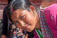 Nepal, Patan.  Nepalese Woman with Red Kumkuma (Sindoor) Mark between the parting of her hair, a symbol of marriage.