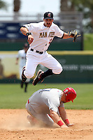 Brevard County Manatees shortstop Shea Vucinich #2 attempts to turn a double play as Cameron Rupp #51 slides in during a game against the Clearwater Threshers at Space Coast Stadium on April 30, 2012 in Viera, Florida.  Clearwater defeated Brevard County 5-1.  (Mike Janes/Four Seam Images)