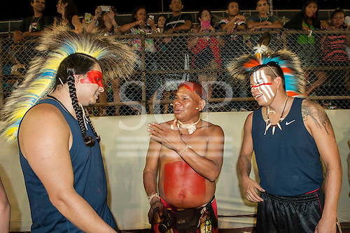 Cree Native American delegates exchange a joke with a Brazilian Xavante indigenous contestant during the International Indigenous Games in Brazil. 27th October 2015