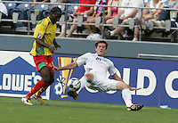 Brad Evans (21) kicks the ball ahead of Shane Rennie (left). USA defeated Grenada 4-0 during the First Round of the 2009 CONCACAF Gold Cup at Qwest Field in Seattle, Washington on July 4, 2009.