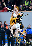 Cormac O Donovan of Clonlara in action against Pearse Lillis of Ballyea  during their senior county final replay at Cusack Park. Photograph by John Kelly.