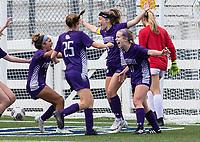 Bella Kieklak (17) of Fayetteville celebrates Fayetteville's first goal with team mates at Wildcat Stadium, Springdale, Arkansas, Friday, May 14, 2021 / Special to NWA Democrat-Gazette/ David Beach