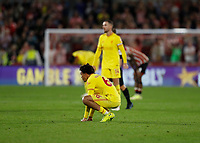 25th September 2021; Brentford Community Stadium, London, England; Premier League Football Brentford versus Liverpool; A dissapointed Trent Alexander-Arnold of Liverpool crouches after full time