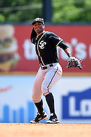 Omaha Storm Chasers second baseman Jimmy Paredes (17) throws to first during a game against the Nashville Sounds on May 20, 2014 at Herschel Greer Stadium in Nashville, Tennessee.  Omaha defeated Nashville 4-1.  (Mike Janes/Four Seam Images)