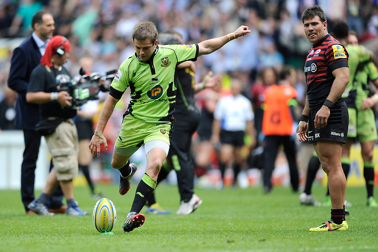 Stephen Myler of Northampton Saints takes the final conversion kick of the Aviva Premiership Rugby Final as the pitch is overrun by the media and other players at Twickenham Stadium on Saturday 31st May 2014 (Photo by Rob Munro)