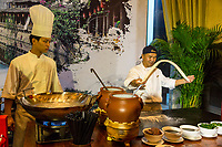 Wenzhou, Zhejiang, China.  Hotel Chef Demonstrating the Making of Noodles.
