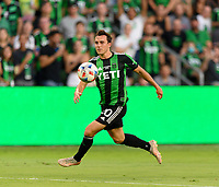 AUSTIN, TX - JUNE 19: Jared Stroud #20 of Austin FC attempts to gain control of a loose ball during a game between San Jose Earthquakes and Austin FC at Q2 Stadium on June 19, 2021 in Austin, Texas.