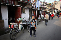 CHINA. Shanghai. A young boy in the old town. Shanghai is a sprawling metropolis or 15 million people situated in south-east China. It is regarded as the country's showcase in development and modernity in modern China. This rapid development and modernization, never seen before on such a scale has however spawned countless environmental and social problems. 2008