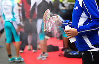 17 SEP 2011 - LA BAULE, FRA - A competitor shakes excess talcum powder from her shoe as she prepares for the start of the final round of the women's French Grand Prix Series at the Triathlon Audencia in La Baule, France (PHOTO (C) NIGEL FARROW)