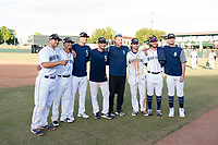 Joe DeCarlo (4), Chris Mariscal (19), Evan White (15), Anthony Misiewicz (56), Andy Lyons (trainer), Ian Miller (9), David McKay (38), and Matt Walker (31), of the Peoria Javelinas and Seattle Mariners organization, pose for a photo after winning the Arizona Fall League Championship game against the Salt River Rafters at Scottsdale Stadium on November 17, 2018 in Scottsdale, Arizona. Peoria defeated Salt River 3-2 in 10 innings. (Zachary Lucy/Four Seam Images)