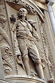 Sarajevo, Bosnia. Detail of relief sculpture of a man on a building in central Sarajevo.