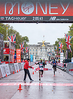 4th October 2020, London, England; 2020 London Marathon; Shura Kitata (ETH) crosses the line on The Mall to win the Elite Men's Race. The historic elite-only Virgin Money London Marathon taking place on a closed-loop circuit around St James's Park in central London on Sunday 4 October 2020.