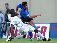 8 May 2004:  MetroStars Tenywa Bonseu battles for the ball against Earthquakes Brian Ching at Spartan Stadium in San Jose, California.   Earthquakes and MetroStars are tied at 5-5.  Mandatory Credit: Michael Pimentel/ISI