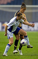 USWNT midfielder (11) Carli Lloyd fights for the ball with Finland's (10) Anna-Kaisa Rantanen during the Four Nations Tournament in  Guangzhou, China.  The US defeated Finland, 4-1.