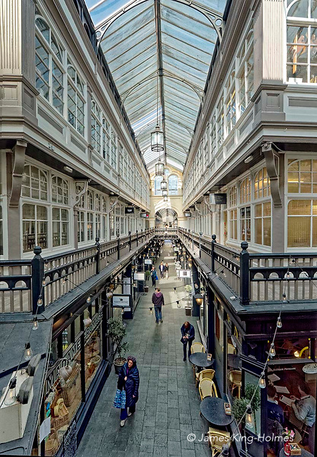 The Castle Arcade, Cardiff. The Casle Arcade in central Cardiff is one of a number of shopping facilities built in this welsh capital city in the 19th Century. Retail and office space occupy two floors of the arcade, with the walkway on the upper floor being reached by staircases. The ground floor passages are occupied by bookshops, cafes, and other small independent traders suited to the historical environment created by the narrow thoroughfare and the Victorian architecture.