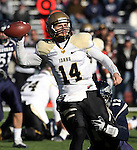 Idaho quarterback Brian Reader (14) throws under pressure from Nevada defender Kaelin Burnett (12) during the first quarter of an NCAA football game in Reno, Nev., on Saturday, Dec. 3, 2011. .Photo by Cathleen Allison