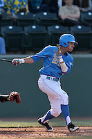Kevin Williams #5 of the UCLA Bruins bats against the Baylor Bears at Jackie Robinson Stadium on February 25, 2012 in Los Angeles,California. UCLA defeated Baylor 9-3.(Larry Goren/Four Seam Images)