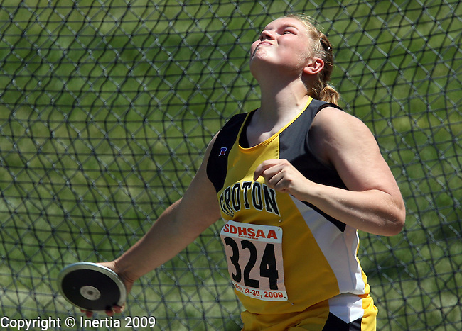SPEARFISH, SD - May 29: Stephanie Fey of Groton throws the discus during the finals Friday at the Class A State Track Meet in Spearfish. (Photo by Dave Eggen/Inertia)