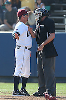 Loyola Marymount Lions Head Coach Jason Gill argues a play with Umpire Jason Kaminsky during a game against the Oregon Ducks at Page Stadium on February 23, 2014 in Los Angeles, California. Oregon defeated Loyola, 4-3. (Larry Goren/Four Seam Images)