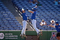 Memphis Tigers Alec Trela (29) celebrates hitting a home run with Ben Brooks (24) during a game against the East Carolina Pirates on May 25, 2021 at BayCare Ballpark in Clearwater, Florida.  Memphis defeated ECU 11-1 in the opening game of the American Athletic Conference Tournament.  (Mike Janes/Four Seam Images)