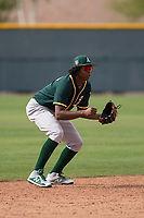 Oakland Athletics shortstop Eric Marinez (7) prepares to field a ground ball during a Minor League Spring Training game against the Chicago Cubs at Sloan Park on March 13, 2018 in Mesa, Arizona. (Zachary Lucy/Four Seam Images)