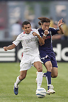 The MetroStars' Amado Guevara bumps Jose Carlos Cancela Duran of the Revolution off the ball. The New England Revolution defeated the MetroStars 4 to 2 at Gillette Stadium, Foxbourgh, MA, on June 25, 2005.