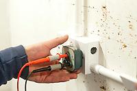 Student electrician testing a domestic socket, Able Skills, Dartford, Kent.